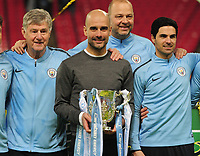 Football - 2019 EFL League Cup Final (Carabao Cup) - Manchester City vs. Chelsea<br /> <br /> Man City manager, Pep Guardiola with the trophy and Mikel Arteta and Brian Kidd (coaches), at Wembley Stadium.<br /> <br /> COLORSPORT/ANDREW COWIE
