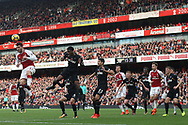 Sead Kolasinac of Arsenal (L) flicks on a corner kick. Premier league match, Arsenal v Swansea city at the Emirates Stadium in London on Saturday 28th October 2017.<br /> pic by Steffan Bowen, Andrew Orchard sports photography.