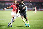 Macclesfield Town forward Arthur Gnahoua challenged by the opponent during the EFL Sky Bet League 2 match between Salford City and Macclesfield Town at the Peninsula Stadium, Salford, United Kingdom on 23 November 2019.
