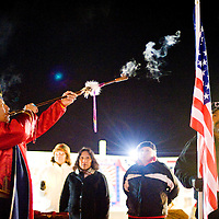 111112     Brian Leddy<br /> Marine veteran Oscar House of Window Rock smokes a pipe during a ceremony to honor veterans Sunday evening at the McKinley Courthouse Square. The annual Veteran's Day event saw dozens of people participate despite the frigid temperatures.