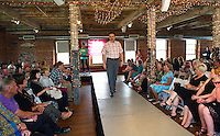 Mayor Ed Engler sports a casual weekend ensemble from Eddie Bauer on the runway during the Belknap Mill Fashion Show on Sunday afternoon.  (Karen Bobotas/for the Laconia Daily Sun)