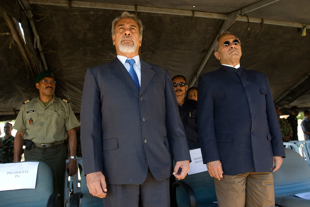 Outgoing President of Timor-Leste, Xanana Gusmao stands beside incoming President Jose Ramos-Horta at a parade put on for Xanana Gusmao by the East Timorese Army.