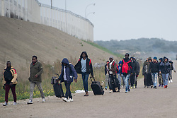 October 24, 2016 - Calais, Northern France, France - Image ¬©Licensed to i-Images Picture Agency. 24/10/2016. Calais, France. Calais Jungle Eviction. Migrants and refugees leaving the Calais Jungled to be bussed out to reception centres across France. It is estimated that 3000 refugees and migrants to be processed. Picture by Pete Maclaine / i-Images (Credit Image: © Pete Maclaine/i-Images via ZUMA Wire)