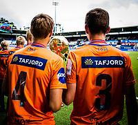 1. divisjon fotball 2018: Aalesund - Åsane (1-0). Neste generasjon Aalesundsspillere med pokalen fra finaleseieren i Norway cup. Her markeres det i pausen av kampen i 1. divisjon i fotball mellom Aalesund og Åsane på Color Line Stadion.