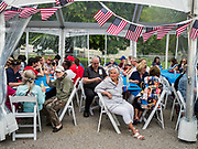 27 MAY 2019 - URBANDALE, IOWA: People at a Memorial Day barbecue hosted by US Senator Cory Booker (D-NJ) at his Iowa campaign office. Sen. Booker is running to be the Democratic nominee for the US Presidency. Iowa traditionally hosts the the first selection event of the presidential election cycle. The Iowa Caucuses will be on Feb. 3, 2020.                PHOTO BY JACK KURTZ