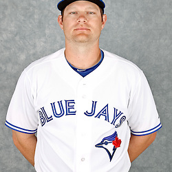 March 2, 2012; Dunedin, FL, USA; Toronto Blue Jays first baseman Adam Lind (26) poses for a portrait during photo day at Florida Auto Exchange Stadium.  Mandatory Credit: Derick E. Hingle-US PRESSWIRE