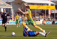 Photo: Ashley Pickering.<br />Colchester United v Norwich City. Coca Cola Championship. 31/03/2007.<br />Chris Martin of Norwich (yellow) rides a tackle by Wayne Brown of Colchester