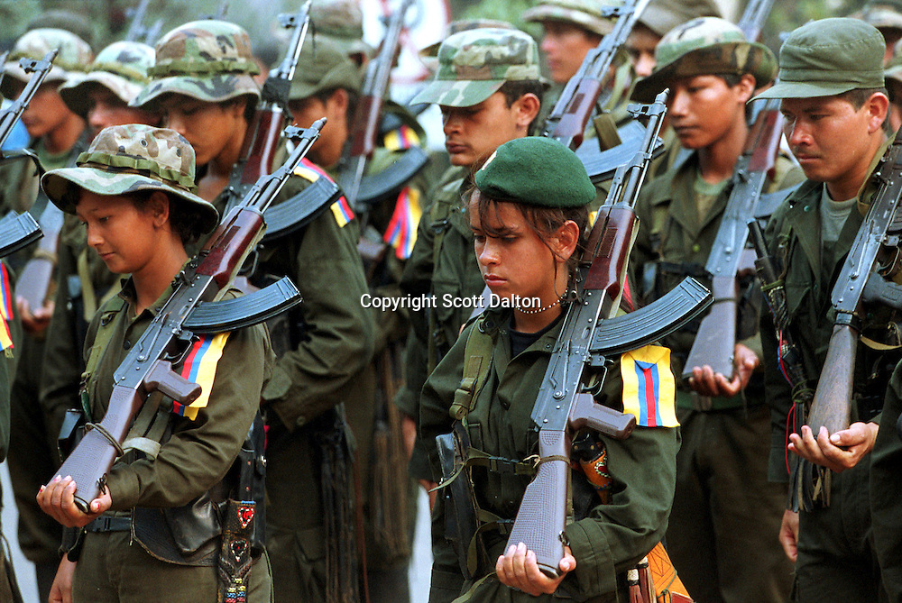Members of the Revolutionary Armed Forces of Colombia, or FARC, stand in formation in San Vicente del Caguan, in southern Colombia. The FARC has been waging war on the Colombian government for decades and financing their war on the state through the drug trade and kidnapping. Many of their members are teenage boys and girls. (Photo/Scott Dalton)