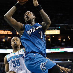 February 1, 2011; New Orleans, LA, USA; Washington Wizards power forward Andray Blatche (7) shoots over New Orleans Hornets power forward David West (30) during the fourth quarter at the New Orleans Arena. The Hornets defeated the Wizards 97-89.  Mandatory Credit: Derick E. Hingle