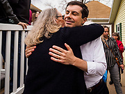 "17 APRIL 2019 - MARSHALLTOWN, IOWA:  Mayor PETE BUTTIGIEG hugs a supporter after a meet and greet at home in Marshalltown, Iowa. People came from as far away as Minneapolis, Minnesota and Rockford, Illinois to meet the mayor of South Bend, Indiana. ""Mayor Pete,"" as he goes by, declared his candidacy to be the Democratic nominee for the US Presidency on April 14. Buttigieg is touring Iowa this week. Iowa traditionally hosts the the first selection event of the presidential election cycle. The Iowa Caucuses will be on Feb. 3, 2020.              PHOTO BY JACK KURTZ"