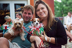 "Leah Browning, with dog ""Sugar Daisy"" adopted two years ago from the Humane Society and Cpt. Scott Browning with Cinnamon.  Christmas Tree Lighting and Seasonal Fundraiser for the Humane Society of St. Thomas.  St. Thomas, USVI.  11 De© Aisha-Zakiya Boyd"