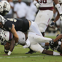 ORLANDO, FL - SEPTEMBER 08:  Mason Cholewa #97 of the UCF Knights sacks Tyrece Nick #3 of the South Carolina State Bulldogs during a football game at Spectrum Stadium on September 8, 2018 in Orlando, Florida. (Photo by Alex Menendez/Getty Images) *** Local Caption *** Mason Cholewa; Tyrece Nick