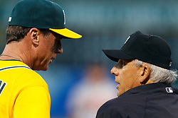 August 15, 2011; Oakland, CA, USA;  Oakland Athletics manager Bob Melvin (left) argues a call with MLB umpire Larry Vanover (right) during the third inning against the Baltimore Orioles at O.co Coliseum.