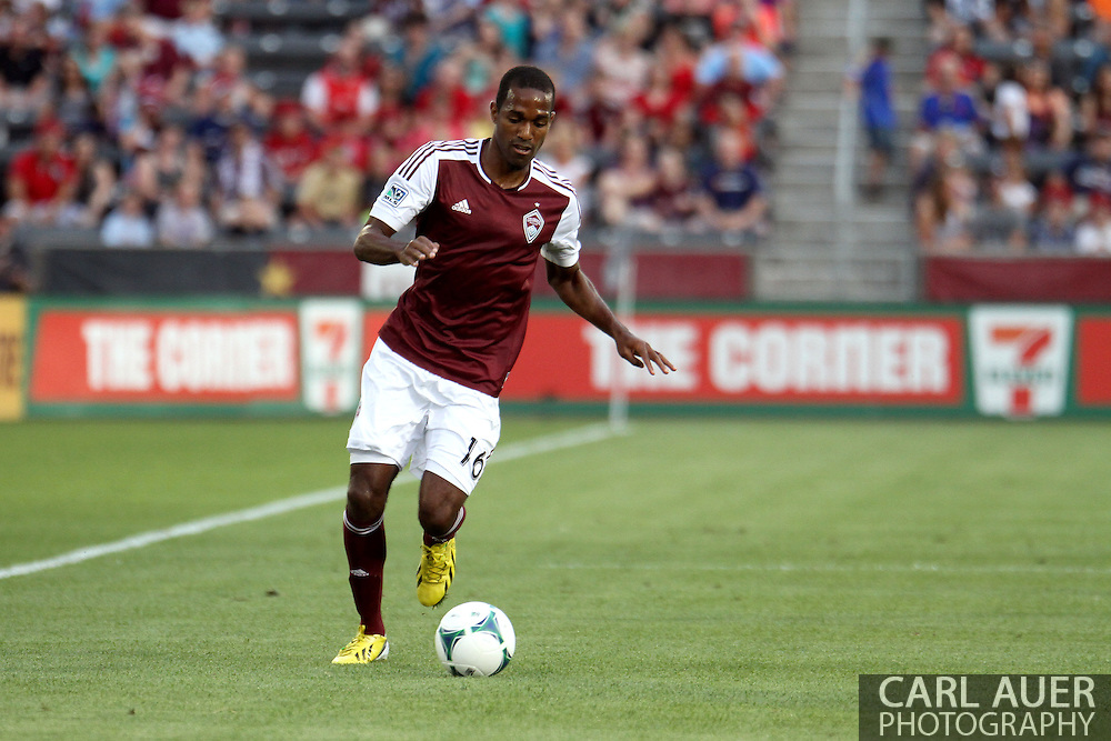 July 4th, 2013 - Colorado Rapids midfielder Atiba Harris (16) brings the ball up the sidelines in the first half of the Major League Soccer match between New York Red Bulls and the Colorado Rapids at Dick's Sporting Goods Park in Commerce City, CO