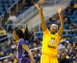 West Virginia Mountaineers guard Bria Holmes (23) makes a three pointer against the TCU Horned Frogs at the WVU Coliseum.