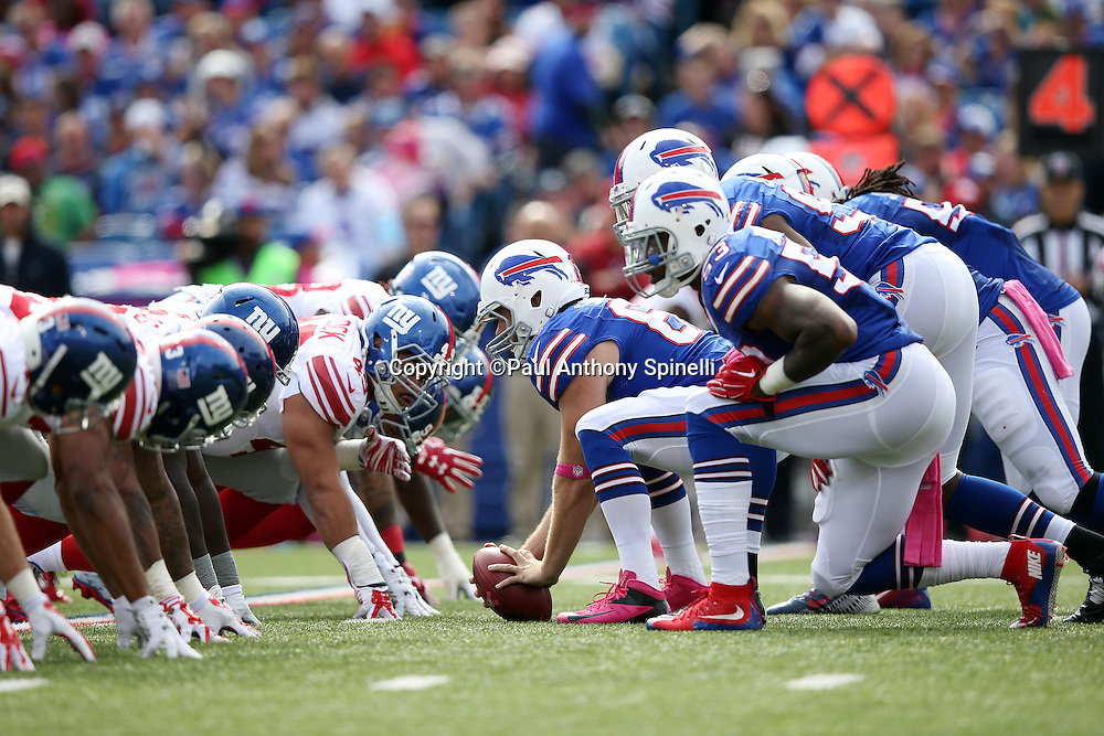 The Buffalo Bills offensive line gets set to snap the ball at the line of scrimmage opposite the New York Giants defensive line during the 2015 NFL week 4 regular season football game against the New York Giants on Sunday, Oct. 4, 2015 in Orchard Park, N.Y. The Giants won the game 24-10. (©Paul Anthony Spinelli)