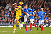 Mitch Pinnock (11) of AFC Wimbledon and Brandon Haunstrup (38) of Portsmouth clash during the EFL Sky Bet League 1 match between Portsmouth and AFC Wimbledon at Fratton Park, Portsmouth, England on 1 January 2019.