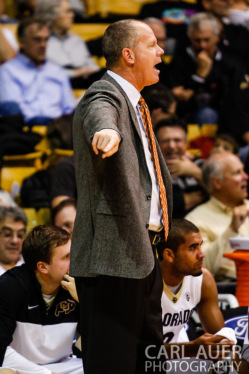 November 16th, 2013:  Colorado Buffaloes head coach Tad Boyle calls out a play in the second half of action in the NCAA Basketball game between the Jackson State Tigers and the University of Colorado Buffaloes at the Coors Events Center in Boulder, Colorado