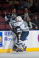 KELOWNA, CANADA - NOVEMBER 25: Turner Ottenbreit #4 of Seattle Thunderbirds checks a player of the Kelowna Rockets into the boards during second period  on November 25, 2015 at Prospera Place in Kelowna, British Columbia, Canada.  (Photo by Marissa Baecker/Getty Images)  *** Local Caption *** Turner Ottenbreit;