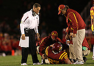 25 OCTOBER 2008: Iowa State head coach Gene Chizik (left) watches as trainers attend to Iowa State offensive lineman Matt Hulbert (67) in the first half of an NCAA college football game between Iowa State and Texas A&M, at Jack Trice Stadium in Ames, Iowa on Saturday Oct. 25, 2008. Texas A&M beat Iowa State 49-35.