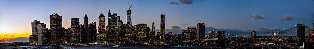US, New York City. Lower Manhattan skyline from Brooklyn Heights Promenade. Stitched panorama.