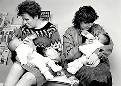 Young mothers feeding their babies at Crabtree toy library, Nottingham, UK March 1986