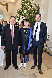 Left to right, NICHOLAS & MARGO SNOWMAN and their son HECTOR SNOWMAN at a party to celebrate the 150th anniversary of Wartski held at The Orangery, Kensington Palace, London, on 19th May 2015.