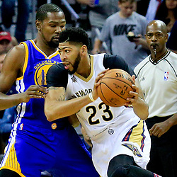 Oct 28, 2016; New Orleans, LA, USA;  New Orleans Pelicans forward Anthony Davis (23) drives past Golden State Warriors forward Kevin Durant (35) during the first quarter of a game at the Smoothie King Center. Mandatory Credit: Derick E. Hingle-USA TODAY Sports