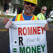 A protester holds up a sign during the Republican National Convention in Tampa, Fla. on Wednesday, August 29, 2012. (AP Photo/Alex Menendez)