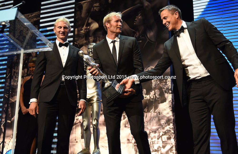 Rowers Hamish Bond and Eric Murray win the overall Supreme Halberg Award presented by Rob Waddell at the 52nd Halberg Awards. Halberg Disability Sport Foundation. Vector Arena, Auckland, New Zealand. Wednesday 11 February 2015. Copyright Photo: Andrew Cornaga / www.photosport.co.nz