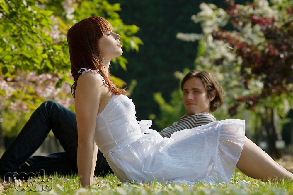 Young Couple Sitting in the Grass
