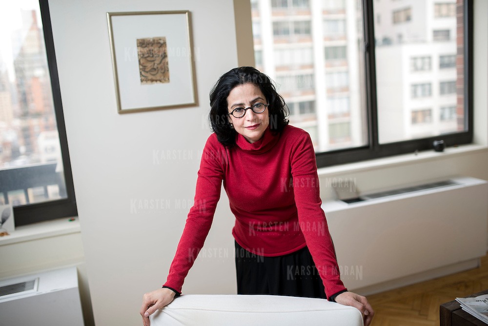 March 4, 2014 - New York, NY : <br /> Sabiha Al Khemir, a writer and curator of Islamic Art, poses for a portrait in her apartment in Manhattan on Tuesday morning, March 4.  Hanging on the wall behind her is a framed piece of 19th century calligraphy from Tunisia.<br /> CREDIT: Karsten Moran for The New York Times