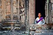 Buddhist nun, one of the many temples surrounding Angkor Wat, Siem Reap, Cambodia