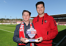 Sky Bet Football League Fan of the month, Joe McCrea, an Exeter City fan, poses with the trophy alongside Exeter City's Pat Baldwin. - Photo mandatory by-line: Harry Trump/JMP - Mobile: 07966 386802 - 18/04/15 - SPORT - FOOTBALL - Sky Bet League Two - Exeter City v Southend United - St James Park, Exeter, England.