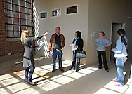 Kelly Bemus (from left) of Skogman Realty shows an unfinished unit to Dennis Mochal, Barb Mochal, Shelby Mochal, 16, and Shayla Mochal, 16, all of Olatha, Kansas at Bottleworks Loft Condominiums, 905 3rd St. SE in Cedar Rapids on Saturday, February 18, 2012. (Stephen Mally/Freelance)