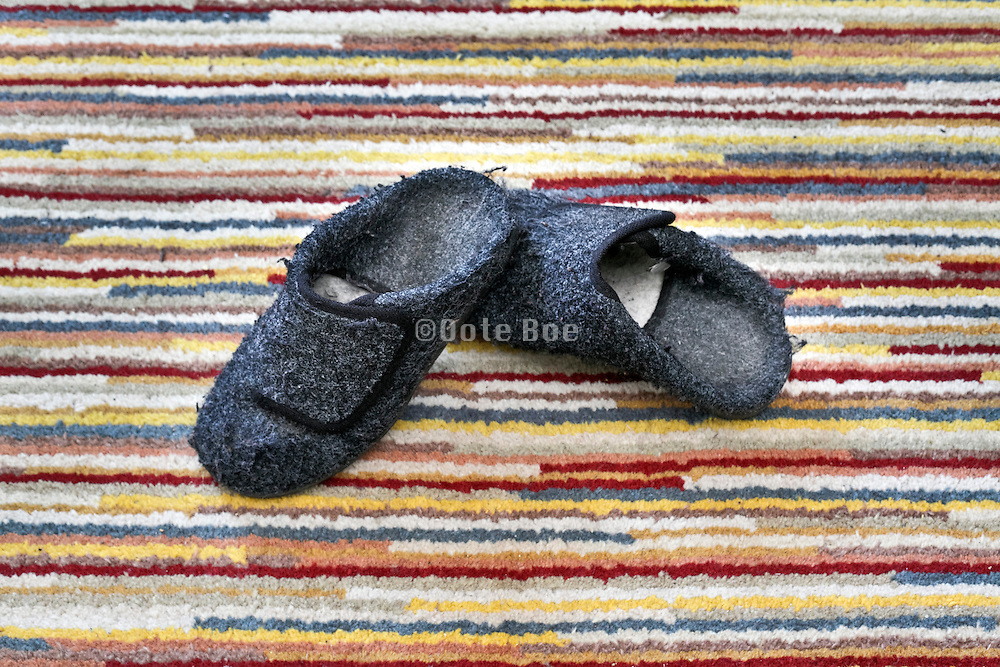 winter indoor slippers on striped carpet