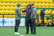 Neil Lennon, manager of Celtic FC speaks to Mortiz Bauer (#13) and Mohamed Elyounoussi (#27) on the pitch before the Ladbrokes Scottish Premiership match between Livingston FC and Celtic FC at The Tony Macaroni Arena, Livingston, Scotland on 6 October 2019.