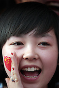 A young woman chants nationalistic slogans at the Olympic Torch relay in the southern city of Wuhan, China.