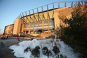 Snow frames the foreground as Lincoln Financial Field stands tall in the background before the Philadelphia Eagles NFL NFC Wild Card football game against the New Orleans Saints on Saturday, Jan. 4, 2014 in Philadelphia. ©Paul Anthony Spinelli