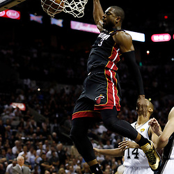 Jun 13, 2013; San Antonio, TX, USA; Miami Heat shooting guard Dwyane Wade (3) dunks against the San Antonio Spurs during the fourth quarter of game four of the 2013 NBA Finals at the AT&T Center. Mandatory Credit: Derick E. Hingle-USA TODAY Sports