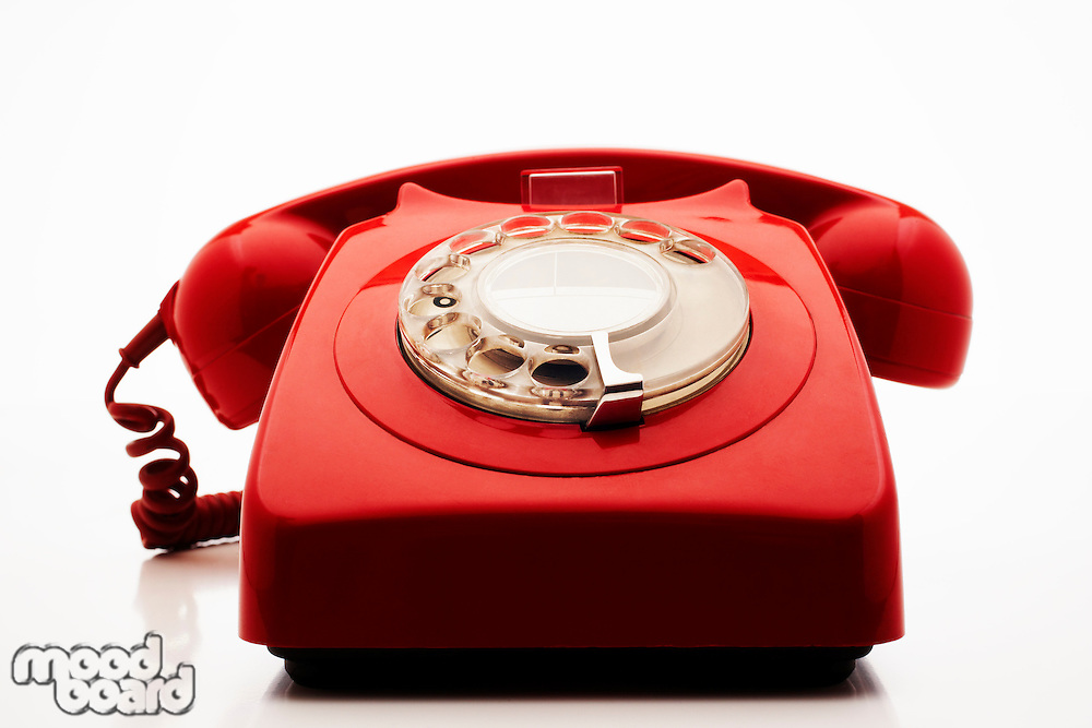 Old fashioned red telephone in studio