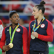 Gymnastics - Olympics: Day 6  Simone Biles #391 of the United States with her gold medal and Alexandra Raisman #395, (right), of the United States with her silver medal after the Artistic Gymnastics Women's Individual All-Around Final at the Rio Olympic Arena on August 11, 2016 in Rio de Janeiro, Brazil. (Photo by Tim Clayton/Corbis via Getty Images)