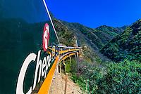 The CHEPE (Chihuahua al Pacifico Railroad) train crosses a bridge traveling through the Copper Canyon, Mexico