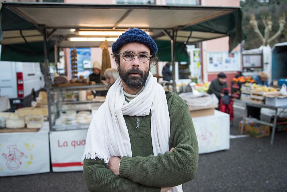 December 5, 2016 - Breil-sur-Roya, France: Cedric Herrou, a 37-year-old farmer, sells products on the mark. He houses migrants on his farm. Cedric is one of the  inhabitants of the village Breil-sur-Roya in the Roya valley who formed a network to help migrants who walked into the valley from Ventimiglia, Italy. <br /> <br /> 5 d&eacute;cembre 2016 - Breil-sur-Roya, France: Cedric Herrou, agriculteur de 37 ans, vend ses produits sur le march&eacute; local. Il abrite des migrants sur sa ferme. Cedric est l'un des habitants du village de Breil-sur-Roya dans la vall&eacute;e de la Roya qui a form&eacute; un r&eacute;seau pour aider les migrants qui sont entr&eacute;s dans la vall&eacute;e par Vintimille, en Italie.