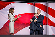 Melania Trump, Donald J. Trump and their son Barron celebrate on stage after Donald Trump was officially nominated as Republican Presidential Candidate at the Republican National Convention in Cleveland.