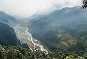 We started trekking at Phedi, 3710 feet, along the Yangdi Khola river valley shown in this image, flanked by fertile rice terraces, near Pokhara, Nepal.