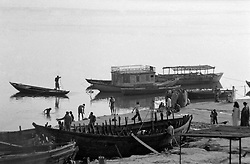 India, Varanasi, 1999. A wedding party waits for the local ferry to cross the Ganges River.