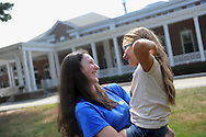 Camp Massapoag counselor, Anna Walker, has a laugh with camper Leanna Palm, Aug. 1, 2014.<br /> Wicked Local staff photo / Kate Flock