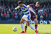 Queens Park Rangers midfielder Jordan Cousins (8) battles for possession with Swansea City midfielder George Byers (28)during the EFL Sky Bet Championship match between Queens Park Rangers and Swansea City at the Loftus Road Stadium, London, England on 13 April 2019.