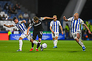 Jonathan Hogg of Huddersfield Town (6) George Evans of Derby County (17) and Aaron Mooy of Huddersfield Town (10) in action during the EFL Sky Bet Championship match between Huddersfield Town and Derby County at the John Smiths Stadium, Huddersfield, England on 5 August 2019.